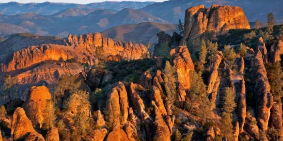 CALIFORNIA - Sunrise on rock spires and ribs in High Peaks and Balconies areas from High Peaks Trail in Pinnacles National Park.